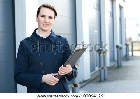 Portrait of business woman in front of warehouse