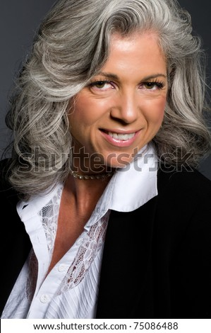 Portrait of business woman in her fifties smiling. - stock photo