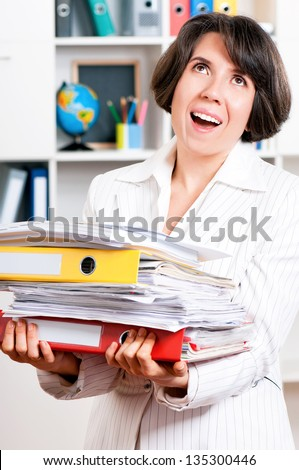 Portrait of business woman or teacher with folders at her office