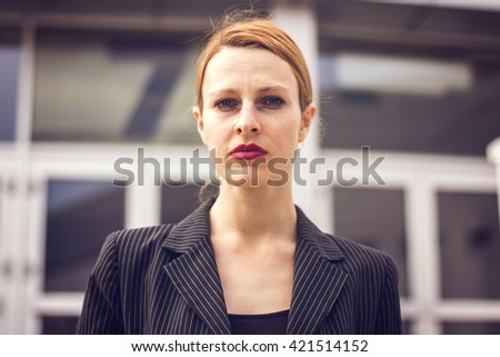 Portrait of business woman outdoors - stock photo