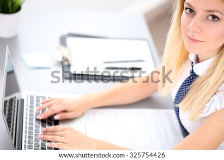 Portrait of business woman  secretary  in office