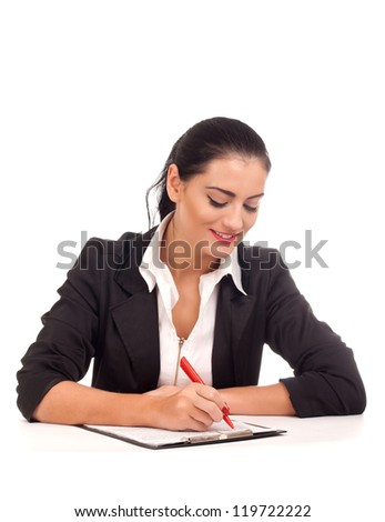 Portrait of business woman signing documents - stock photo