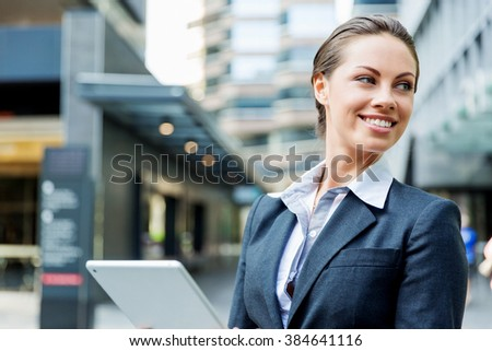 Portrait of business woman smiling outdoor - stock photo