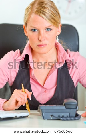 Portrait of business woman waiting phone call - stock photo