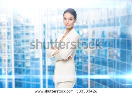 Portrait of business woman with hands crossed, blue background. Concept of leadership and success - stock photo