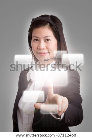 Portrait of business women call center pushing a button on a touch screen interface .Focus on face. - stock photo