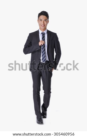 Portrait of business young man of Asian, full length portrait walking in studio - stock photo