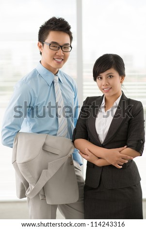 Portrait of businessman and businesswoman in office
