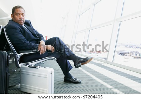 Portrait of businessman at airport