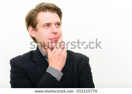 Portrait of businessman daydreaming