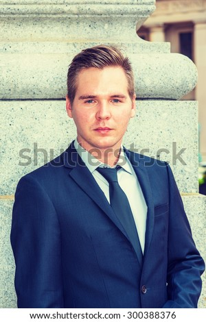 Portrait of Businessman. Dressing in dark blue suit, black tie, a young professional standing outside office, charmingly looking at you, confident, believing and success. Instagram filtered effect - stock photo