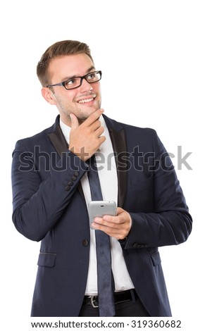 portrait of Businessman grinning, finger in chin, holding a cellphone. isolated over white background - stock photo