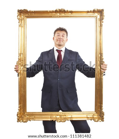 Portrait of businessman holding a golden frame on white background - stock photo