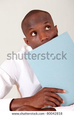 Portrait of businessman holding files - stock photo