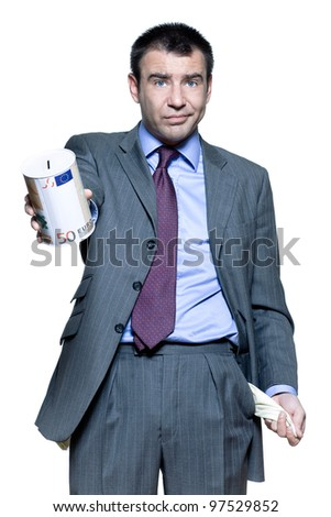 Portrait of businessman holding money box and showing empty pocket in studio on isolated white background - stock photo