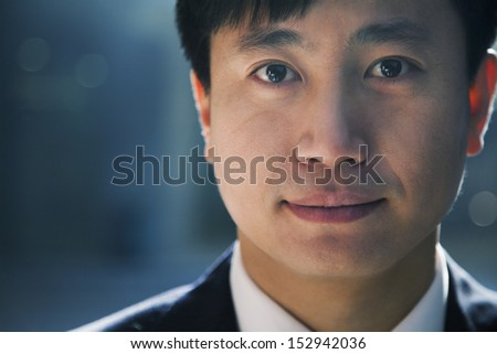Portrait of businessman in a parking garage, close-up - stock photo