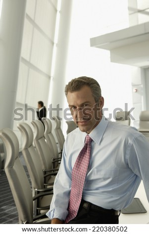 Portrait of businessman in conference room - stock photo