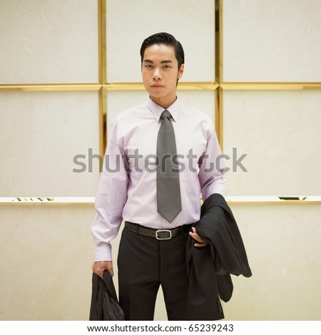 Portrait of businessman in elevator