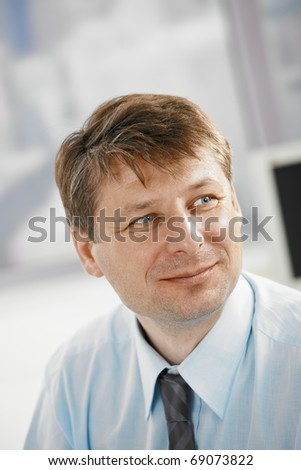 Portrait of businessman in office, smiling. - stock photo