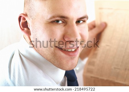 Portrait of  businessman reading a newspaper