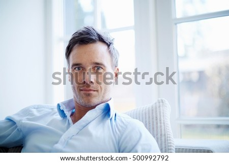 Portrait of businessman relaxing at home