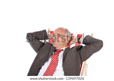 portrait of businessman relaxing in desk chair - stock photo