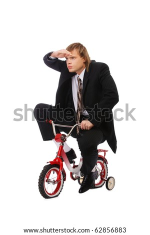 portrait of businessman riding on child's bicyce and looking forward - stock photo