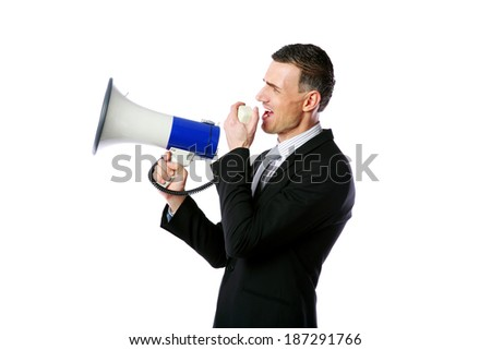 Portrait of businessman shouting through megaphone isolated on white background - stock photo