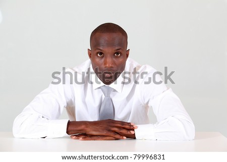 Portrait of businessman sitting at his desk