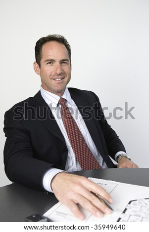 Portrait of businessman sitting in an office.