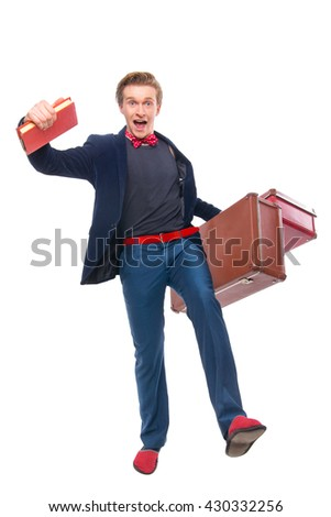 Portrait of Businessman sitting on his suitcase while and smile