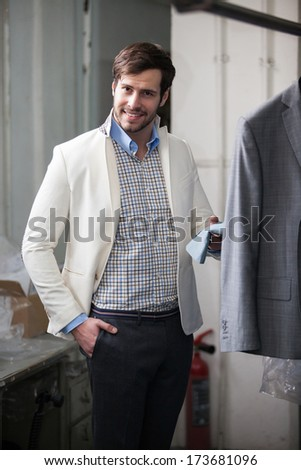 Portrait of businessman smiling, elegant and classic at the store. - stock photo