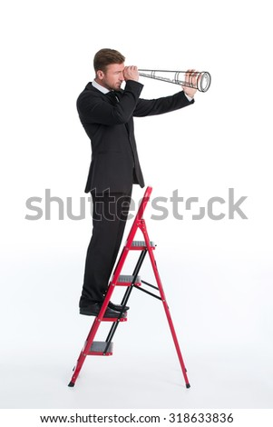 Portrait of businessman standing on the ladder and using telescope isolated on white. Man reached the higher position to help his company. - stock photo