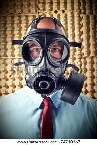 portrait of businessman wearing classic gas mask