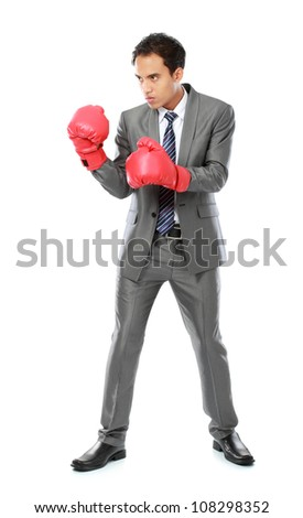 portrait of businessman with boxing glove ready to fight - stock photo