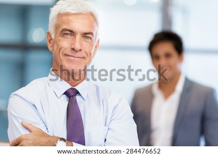 Portrait of businessman with collegue on background - stock photo