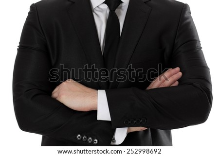 Portrait of businessman with crossed arms. Isolated on white. - stock photo