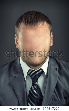 Portrait of businessman without face - stock photo