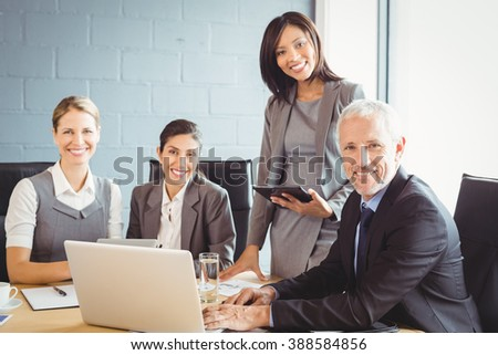 Portrait of businesspeople at a meeting in conference room - stock photo