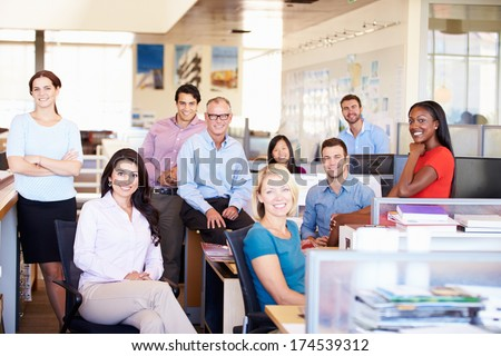Portrait Of Businesspeople In Modern Open Plan Office - stock photo