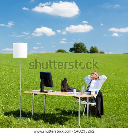 Portrait of businesspeople resting in the office outdoors - stock photo