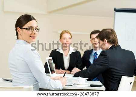 Portrait of businesspeople working with smart employer sitting aback and looking at camera