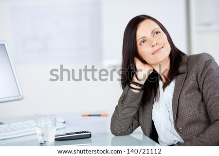 Portrait of businesswoman daydreaming inside the office - stock photo