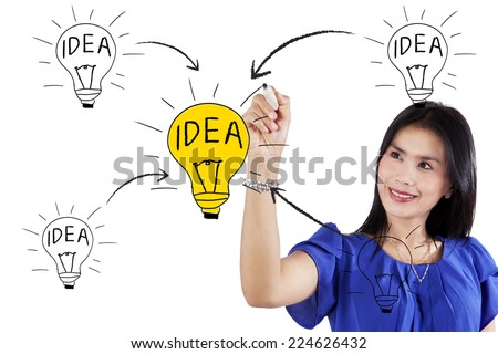 Portrait of businesswoman drawing her idea concept, isolated on white background - stock photo