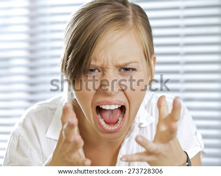 Portrait of businesswoman shouting