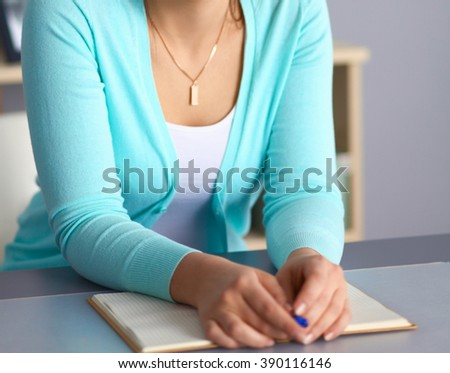 Portrait of  businesswoman sitting at  desk  - stock photo