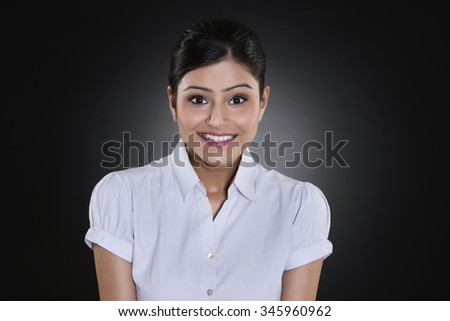 Portrait of businesswoman smiling - stock photo