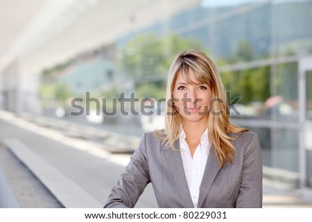 Portrait of businesswoman standing outside offices - stock photo