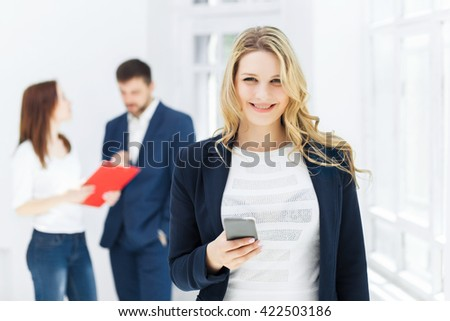 Portrait of businesswoman talking on phone in office - stock photo