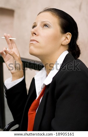 portrait of businesswoman with cigarette - stock photo